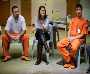PORTLAND, MAINE -- 11/13/14 -- University of New England occupational therapy student Jessica Brown plays a word game with prisoners at the Cumberland County Jail in Portland, including Zac Constiner (left) and Joey Bowie (right). Brown volunteers her time with the ANEW Approach addiction treatment program. Troy R. Bennett | BDN